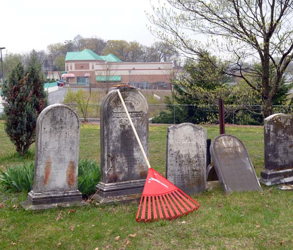 An orange rake in an old cemetery in Eldersburg, Maryland.
