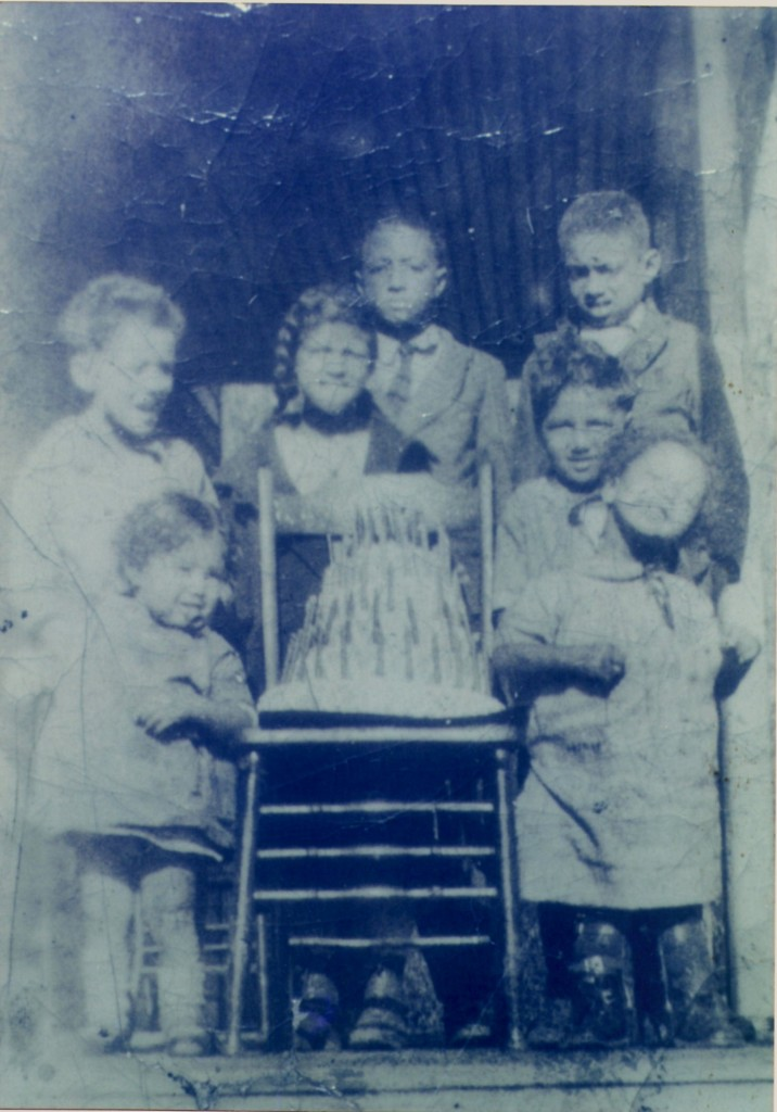 Dorsey children with the birthday cake their father made...out of wood.